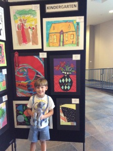Hank Nagem poses by his painting at the BRACE art show